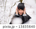 Portrait of a beautiful girl in winter forest 13835640