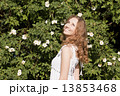 Photo of blonde girl with bright sincere smile standing near bri 13853468
