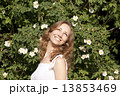 Photo of blonde girl with bright sincere smile standing near bri 13853469