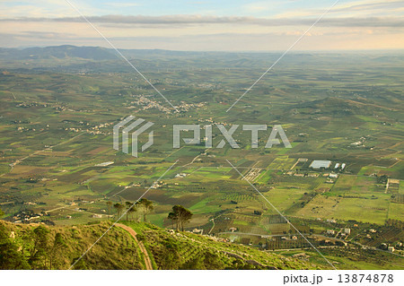 Picturesque view to the fields in rural area and hills with trees at the background  13874878