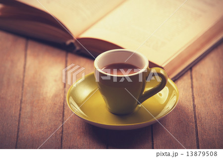 green cup of the coffee and little gift. 13879508