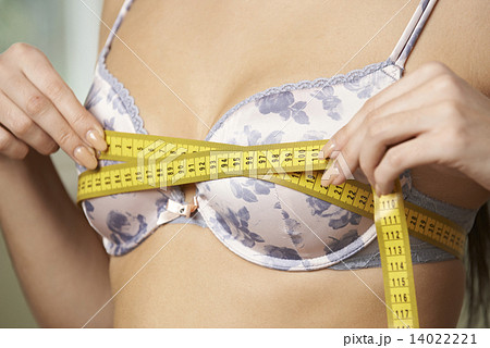 Woman Measuring Her Bra Size With Tape Measure 14022221