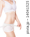 Slimming woman measuring hip with tape 14041525