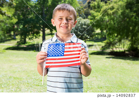 Little boy waving american flag 14092837