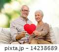 happy senior couple with red heart shape 14238689