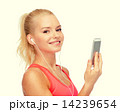 smiling sporty woman with smartphone and earphones 14239654