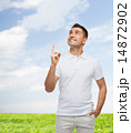 smiling man in white t-shirt pointing finger up 14872902
