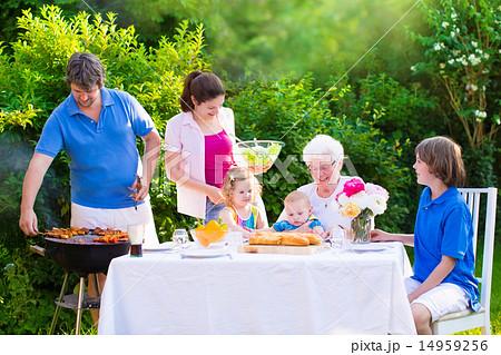 Big happy family enjoying bbq grill in the garden 14959256