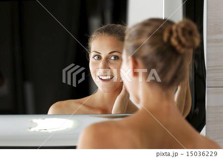 Woman Getting Ready In Bathroom