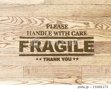 fragile word stamp on wood plank backgroundの写真素材 [15066173] - PIXTA