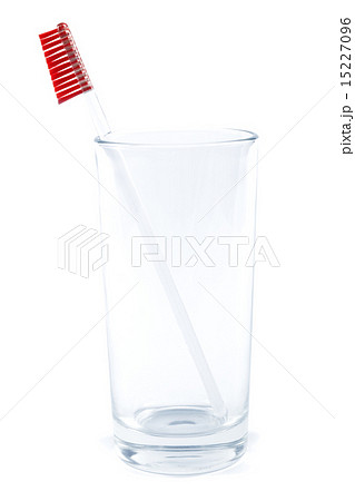 Toothbrush in a glass on a white background.の写真素材 [15227096] - PIXTA