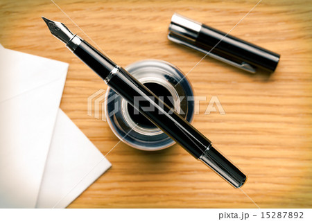 fountain pen and inkwell on deskFountain Pen And Inkwell