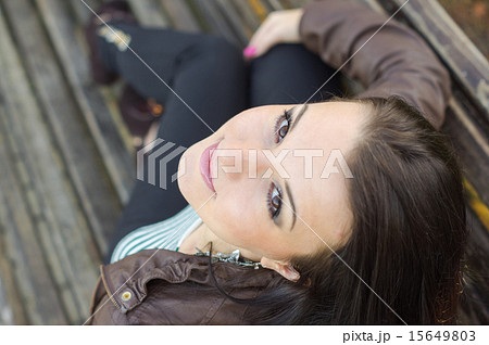 beautiful and sexy girl sitting on bench outdoorsの写真素材 [15649803] - PIXTA
