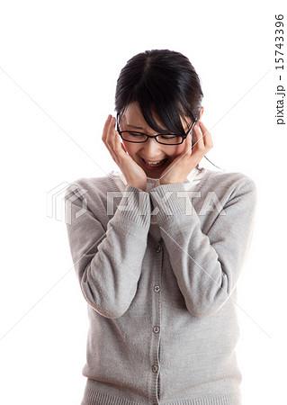 写真素材: 落ち込んだ女性 顔を手で覆う