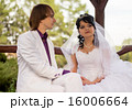 Couple love bride and groom posing sitting on wood 16006664