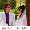 Couple love bride and groom posing sitting on wood 16006666