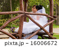 Couple love bride and groom posing sitting on wood 16006672