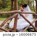Couple love bride and groom posing sitting on wood 16006673