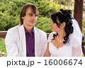 Couple love bride and groom posing sitting on wood 16006674