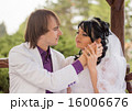 Couple love bride and groom posing sitting on wood 16006676