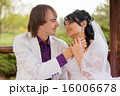 Couple love bride and groom posing sitting on wood 16006678