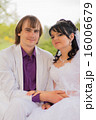 Couple love bride and groom posing sitting on wood 16006679