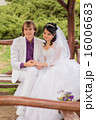 Couple love bride and groom posing sitting on wood 16006683