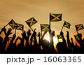 Group of People Waving Flag of Jamaica in Back Lit 16063365