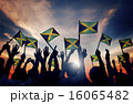 Group of People Waving Flag of Jamaica in Back Lit 16065482
