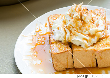 Golden honey toast with whipped cream on top 16299789