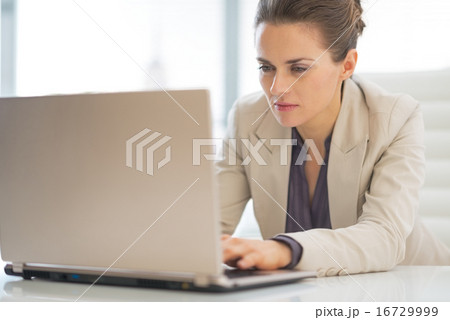 Business woman working on laptop in office