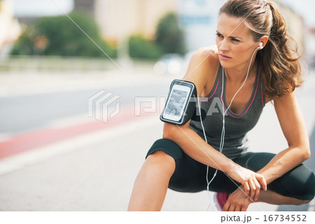 Portrait of fitness young woman outdoors in the city
