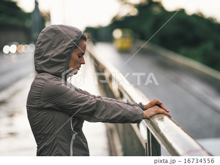 Portrait of fitness young woman in rainy city