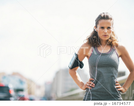 Portrait of fitness young woman in the city