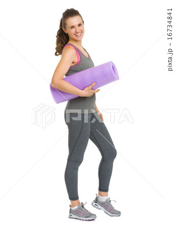 Full length portrait of smiling healthy young woman with fitness