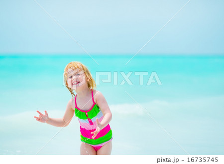 Portrait of happy baby girl at seaside