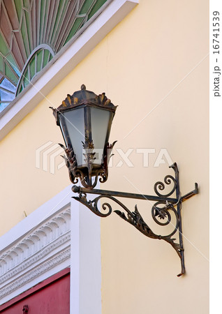 Old lamp with stained glass window on wallの写真素材 [16741539] - PIXTA