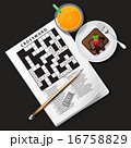 crossword with orange juice and chocolate cake 16758829