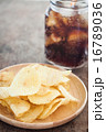 Crispy potato chips with iced cola 16789036