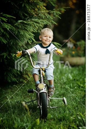little happy boy on bike