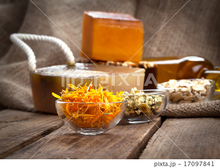 herbal calendula in the glass bowl, on wooden