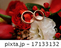 gold rings on a wedding bouquet close up 17133132