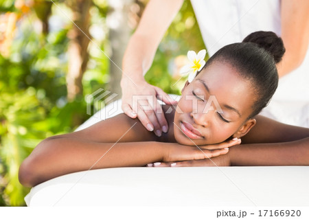 Beautiful woman receiving massage at health farm