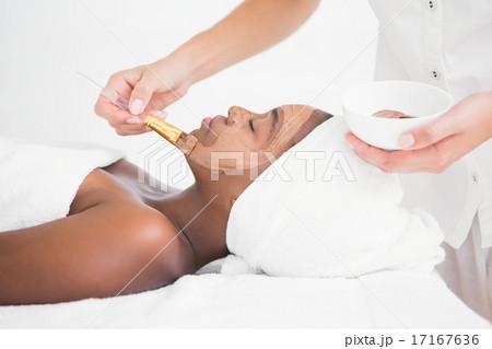 Pretty woman getting a chocolate facial treatment