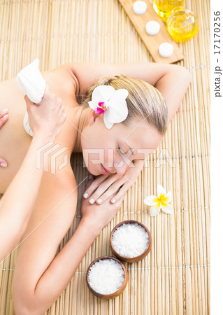 Attractive woman getting massage on her back