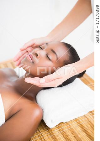 Pretty woman enjoying a head massage