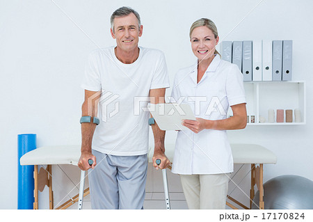 Doctor and patient with crunch looking at camera