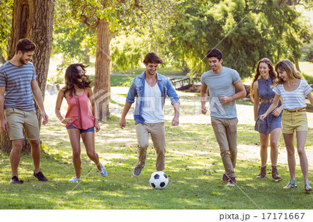 Happy friends in the park with football 17171667