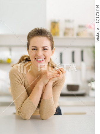 Portrait of smiling young woman in modern kitchen