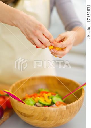 Closeup on housewife preparing vegetable salad